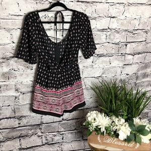 Three pink Hearts Black/pink romper. Size XS.